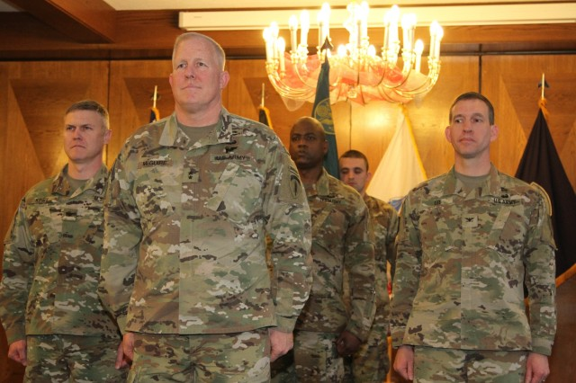 Col. William L. Kirby (Left to right), incoming commander of the 19th Battlefield Coordination Detachment, Maj. Gen. Timothy McGuire, deputy commanding general, U.S. Army Europe, Sgt. Maj. Richard A. Dickey, 19th BCD senior enlisted advisor and outgoing commander Col. David S. Lee finish a change of command ceremony at the Officer's Club, Ramstein Air Base, Germany Dec. 12, 2017.