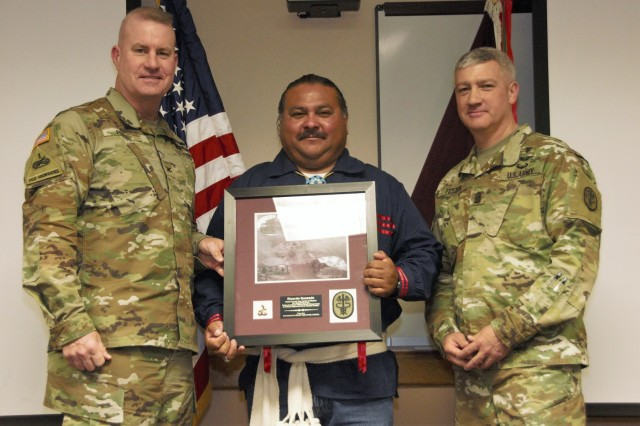 (From left) Col. Erik Rude, commander, William Beaumont Army Medical Center, Ricardo Quezada, tribal member and director of cultural preservation, Ysleta Del Sur Pueblo, and Command Sgt. Maj. Michael Fetzer, command sergeant major, WBAMC, pose for a picture with Quezada holding a plaque for his participation during the National American Indian Heritage Month observance at WBAMC, Nov. 30.
