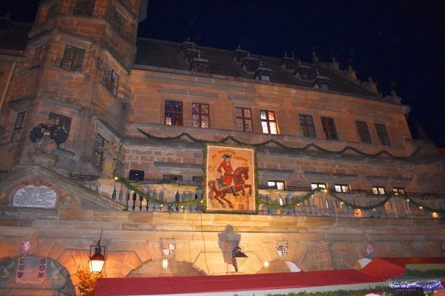 "ROTHENBURG, Germany -- U.S. Army Garrison Ansbach (USAG Ansbach), community members were invited to take part in the construction of a giant festive advent calendar Dec. 7, by Rothenberg ob der Tauber Bürgermeister (Mayor) Dieter Kölle during the annual ""Reiterlesmarket"" Christmas market. The Christmas market in Rothenburg is one of the most beloved in Germany and has been regularly held and celebrated since the 15th century. An Advent calendar is a special holiday calendar popular throughout Europe with windows that families use to count down the days of Advent in anticipation of Christmas. Each day a new window or door is opened often revealing a holiday illustration, or including a small toy or chocolate bonbon to count down one-by-one the days until Christmas Eve. To learn more about the people and facilities of the U.S. Army Garrison Ansbach (USAG Ansbach) and the people they support in Ansbach, Katterbach and Illesheim, visit the community website at http://ansbach.army.mil"