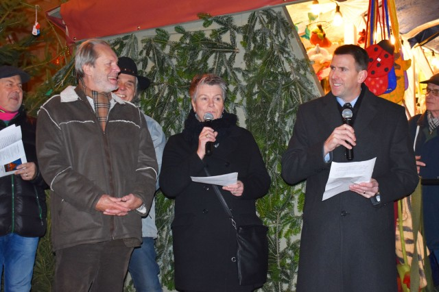 "ROTHENBURG, Germany -- U.S. Army Garrison Ansbach (USAG Ansbach) commander Col. Benjamin Jones (pictured, right), and Ansbach community members were invited to take part in the construction of a giant festive advent calendar Dec. 7, by Rothenberg ob der Tauber Bürgermeister (Mayor) Dieter Kölle (left), during the annual ""Reiterlesmarket"" Christmas market. The Christmas market in Rothenburg is one of the most beloved in Germany and has been regularly held and celebrated since the 15th century. An Advent calendar is a special holiday calendar popular throughout Europe with windows that families use to count down the days of Advent in anticipation of Christmas. Each day a new window or door is opened often revealing a holiday illustration, or including a small toy or chocolate bonbon to count down one-by-one the days until Christmas Eve. To learn more about the people and facilities of the U.S. Army Garrison Ansbach (USAG Ansbach) and the people they support in Ansbach, Katterbach and Illesheim, visit the community website at http://ansbach.army.mil"