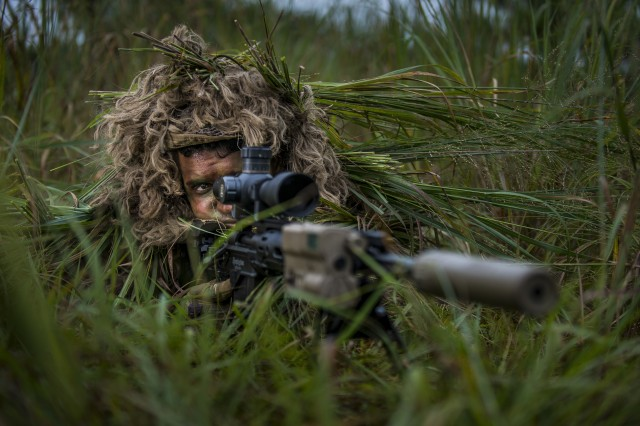 Sgt. Ian Rivera-Aponte, a U.S. Army Reserve sniper and infantryman with the 100th Infantry Battalion, Honolulu, Hawaii, poses for a promotional photo shoot for Army Reserve recruiting at Joint Base McGuire-Dix-Lakehurst, New Jersey, July 26, 2017.