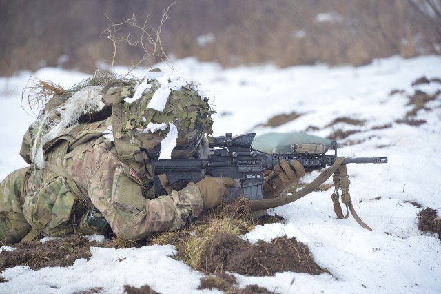 A U.S. Army paratrooper, assigned to 2nd Battalion, 503rd Infantry Regiment, 173rd Airborne Brigade, engages targets during a recon and sniper break contact live fire exercise at Grafenwoehr Training Area, Germany, Feb. 6, 2017.