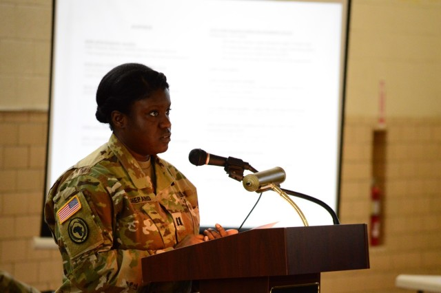 "ANNAPOLIS, Md.— Capt. Morgan Shepard speaks at the Cyber and Information Operations Symposium held at the Annapolis Readiness Center, Nov. 19. Shepherd, commander of the 110th IO Battalion's Field Support Company, has deployed in the past as an IO planner to Djibouti and was responsible for moderating a panel about IO in the Horn of Africa. ""My goal was to make sure the company grade officers and junior NCOs in the audience understood the value of IO, especially those who are just being introduced to it and are not clear exactly what IO is or how it is valuable,"" said Shepherd."
