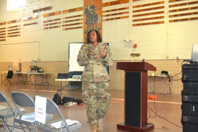 ANNAPOLIS, Md.—Chief Warrant Officer 5 Tywanda B. Morton speaks to attendees at the Cyber and Information Operations Symposium about opportunities and benefits of becoming a warrant officer in the cyber, military intelligence and signal fields. The symposium was the first of its kind for the Maryland National Guard and was hosted by the 110th IO Battalion at the Annapolis Readiness Center, Nov. 19, and provided an opportunity for experts in these fields to share information and build relationships.