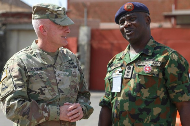 Brig. Gen. Eugene LeBoeuf, the U.S. Army Africa acting commanding general, meets with Col. R.L. Pam during an equipment handover between the U.S. Embassy to Nigeria and Nigeria army's 20th Infantry Battalion in Abuja, Nigeria. A team of Soldiers from U.S. Army Security Assistance Command will deploy to Nigeria next year to assist in training for the Nigerian army.