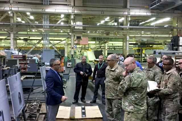 Watervliet Arsenal Chief of Manufacturing John Zayhowski, left, briefs Gen. Gus Perna about the Arsenal's efforts manufacturing parts for a future gun system.