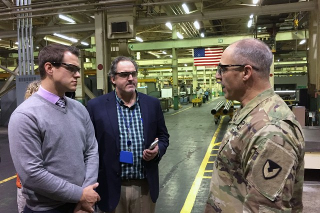 Gen. Gus Perna, commander of the U.S. Army Materiel Command, is interviewed by Spectrum News reporter Geoff Redick, left, and Times Union reporter Larry Rulison during Perna's visit to Watervliet Arsenal, Dec. 11.