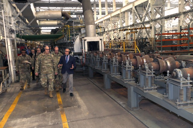 Gen. Gus Perna walks with Chief of Manufacturing John Zayhowski by the heat treatment area.