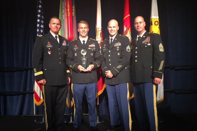 October: Maj. Gen. Kent Savre, Maneuver Support Center of Excellence and Fort Leonard Wood commanding general, and Command Sgt. Maj. Jon Stanley, MSCOE and Fort Leonard Wood command sergeant major, pose with Sgt. 1st Class Ryan McCarthy, U.S. Army NCO of the Year, left, and Sgt. 1st Class Chad Hickey, TRADOC Drill Sergeant of the Year, at the annual AUSA awards ceremony.