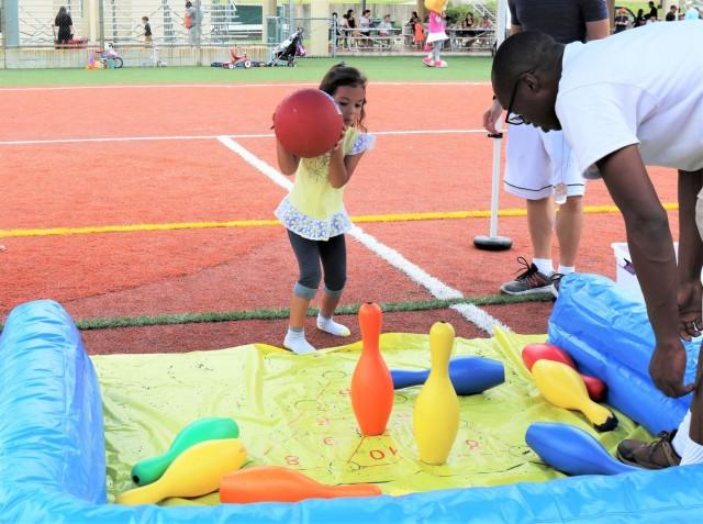 Transportation battalion steers children toward happiness
