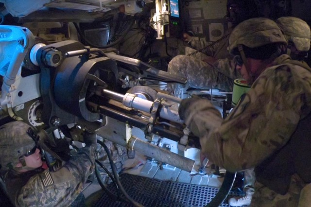 Soldiers assigned to Battery C, 3rd Battalion, 16th Field Artillery Regiment, 210th Field Artillery Brigade, 2nd Infantry Division/ROK-US Combined Division conducts fire mission inside an M109A6 Paladin during their Tables XII certification at Fire Point 95, Yeoncheon, Republic of Korea, Dec. 6, 2017. The live-fire exercise was designed to certify the battalion ensuring they can operate effectively within the brigade, and to enhance their readiness for real time firing missions. (U.S. Army photo by Sgt. Michelle U. Blesam, 210th FAB Public Affairs)