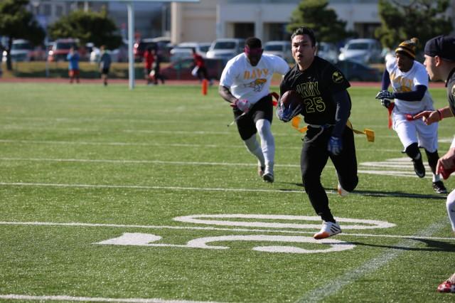 Donnie Osborne, Team Army player, runs toward the end zone during the annual Army vs. Navy flag football game Dec. 9, 2017 at Naval Air Facility Atsugi's Reid Memorial Stadium. (U.S Army photo by Noriko Kudo)