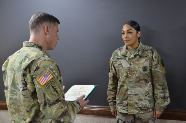 Staff Sgt. Emily M. Medina is awarded the Department of Army Certificate of Achievement by USAG Yongsan Commander Col. J. Scott Peterson