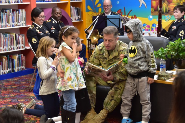 U.S. Army Garrison Yongsan Commander Col. J. Scott Peterson reads a storybook to children during the 2017 Thanksgiving Storyhour, Nov. 4, at the Yongsan Library.