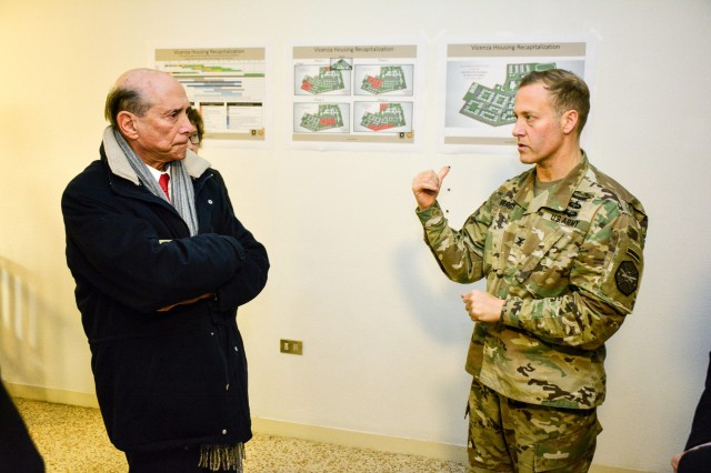 USAG Italy Garrison Commander Col. Erik Berdy briefs U.S. Ambassador to Italy Lewis Eisenberg at Villaggio housing area during a visit to the Vicenza Military Community on Dec. 5, 2017. (U.S. Army photo by Mark Turney)