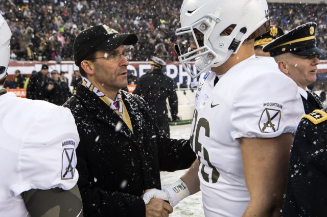 Secretary of the Army Dr. Mark T. Esper shakes a West Point player's hand at the annual Army-Navy game, Dec. 9, 2017.