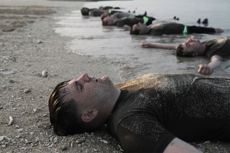 Soldiers from of the Special Forces Basic Combat Course wash off on the beach shore after a morning physical fitness training session at Torii Station, Okinawa, Japan., Nov. 7, 2017. Soldiers participating in SFBCC will endure rigorous training for 2 weeks, in order to educate students on Special Forces tactics, training and skills.