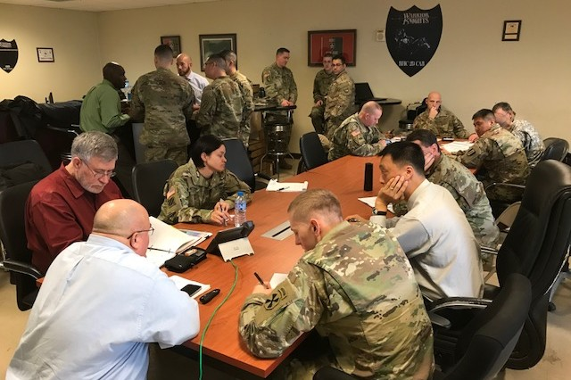 Rick Stoverink (lower left), representing PEO C3T's unit set fielding plans and operations division, provides an overview to Active Duty units during a recent synchronization conference at Camp Humphreys, Korea.