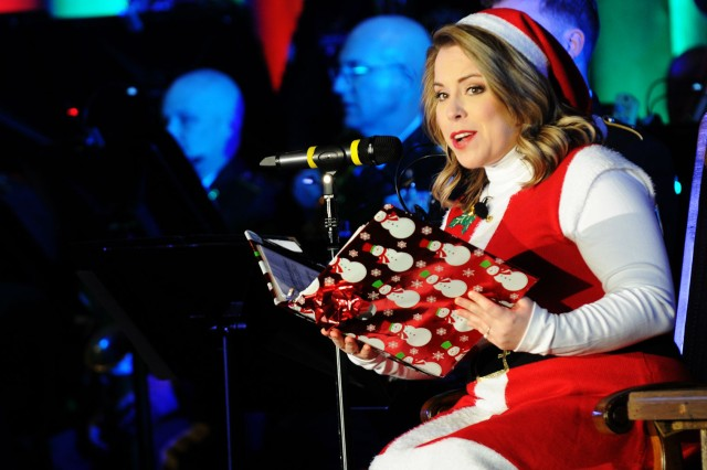 Devon Sellers, WTVY news anchor, recites 'Twas the Night Before Christmas' with the accompaniment of the MCOE Band during the Commanding General's Holiday Concert at the post theater Dec. 11.