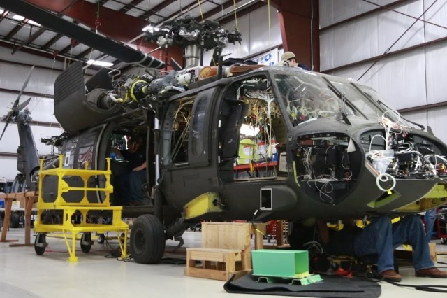 AMRDEC's Prototype Integration Facility assisted the Utility Helicopter Project Management Office in developing and qualifying the UH-60V aircraft. The UH-60V features a digital cockpit that updates the legacy analog gauges. This will achieve a similar Pilot Vehicle Interface to the UH-60M, meet Global Air Traffic Management requirements, and address obsolescence issues.