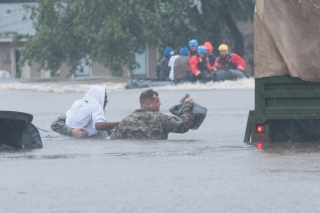 North Carolina Army National Guardsmen and local emergency services assist with evacuation efforts in Fayetteville, N.C., Oct. 08, 2016. Heavy rains caused by Hurricane Matthew have led to flooding as high as five feet in some areas. (U.S. Army National Guard photo by Staff Sgt. Jonathan Shaw, 382nd Public Affairs Detachment/Released)