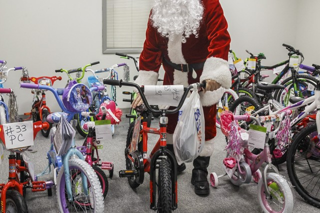 Anniston Army Depot's 2017 Christmas Cheer program culminated Dec. 13 with the delivery of three truckloads of gifts and bicycles to Calhoun County's Department of Human Resources office in Anniston.