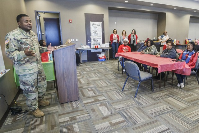 Sgt. Maj. Ronald Ferdinand speaks to employees of Anniston Army Depot and the Calhoun County's Department of Human Resources following the depot's Dec. 13 delivery of three truckloads of gifts and bicycles to the DHR office in Anniston as part of the installation's 2017 Christmas Cheer program.