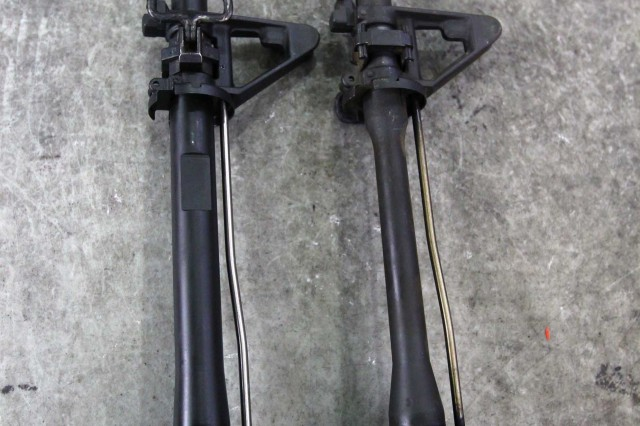 The M4A1 barrel (left) length is the same as the M4 barrel (right), but the more robust barrel adds a little weight to the weapon (less than 1 pound). This M4 barrel had its compensator, or flash hider, removed during the conversion.
