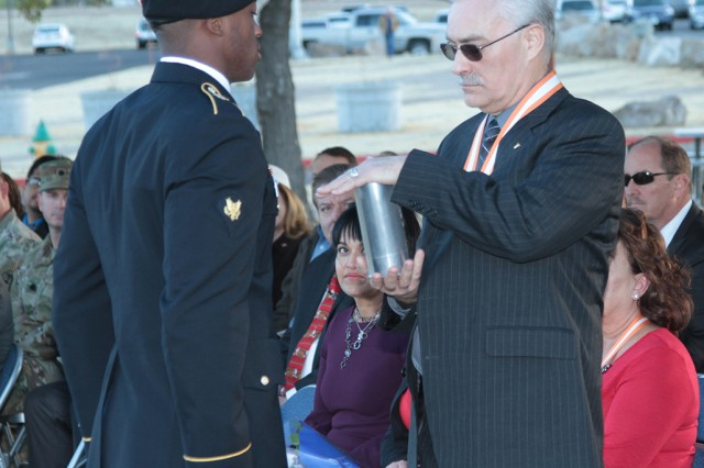 Daniel Q. Bradford, Deputy to the Commander and Senior Technical Director, receives a custom shell casing from the NETCOM Salute Battery, honoring his time and service with NETCOM. Bradford departs after more than 10 years with the command.