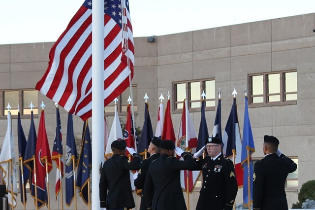 NETCOM Soldiers bring down the colors at the end of the farewell ceremony honoring Daniel Q. Bradford, Deputy to the Commander and Senior Technical Director. Bradford departs after more than 10 years with the command.