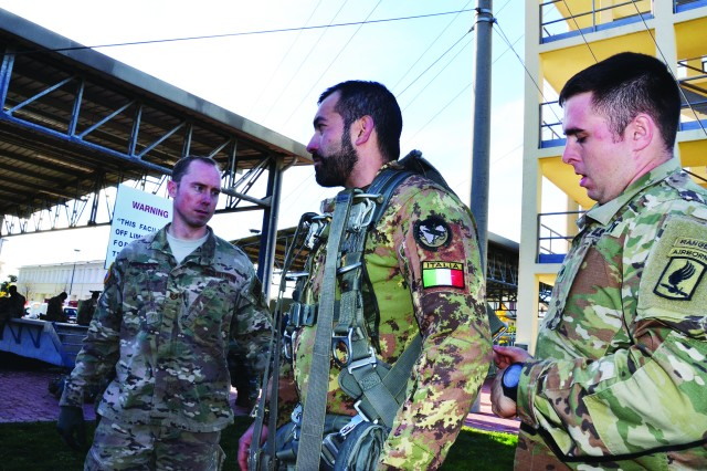 Tech. Sgt. Casey Fletcher (left), U.S. Air Force Detachment 3, 7th Weather Squadron, receives basic orientation at the three-story Ederle Airborne jump tower with one of the Alpini soldiers during the Tactical Weather Exchange, also known as TWX 2017, Nov. 15. Fletcher acted as liaison alongside Tech. Sgt. Rafael Delgado, guiding the Alpini in the Italian language throughout the week. Soldiers from 173rd Infantry Brigade Combat Team (Airborne) checked Alpini soldiers' gear during the orientation.