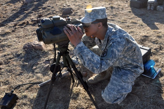 Spc. Kamaris Dickson, with HHB 1st Battalion, 161 Field Artillery from Kansas, uses a range finder while working with the Hunter and Killer platforms at the Maneuver Fires Integrated Experiment, Dec. 11, at Fort Sill. (Photo by Monica K. Guthrie)