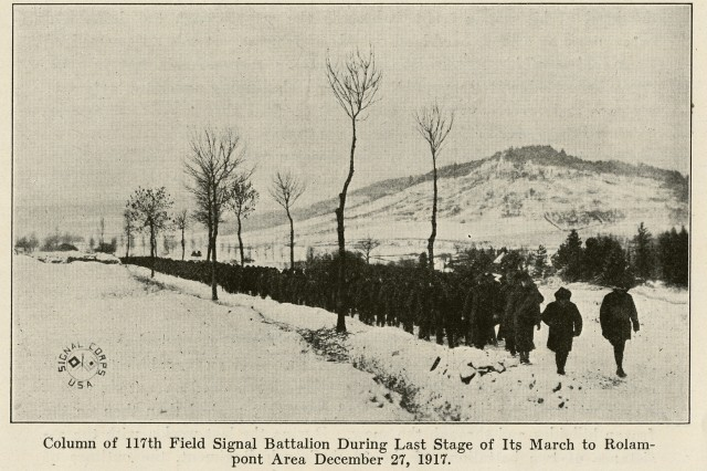 "In this photograph from the book ""the Story of the Rainbow Division"" Missouri National Guard Soldiers of the 117th Field Signal Battalion of the 42nd Division make their way through the snowy French countryside during December 1917 in what became known as the ""Valley Forge Hike"". The troops marched 100 kilometers in the snow from the Vaucouleurs to Rolampont France."