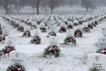 Snow falls on Section 60 of Arlington National Cemetery, Jan. 7, 2017, in Arlington, Va.