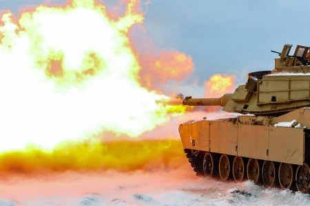 A round is fired from an M1A2 Main Battle Tank during a live-fire accuracy screening tests at the Presidential Range in Swietozow, Poland, Jan. 16, 2017.