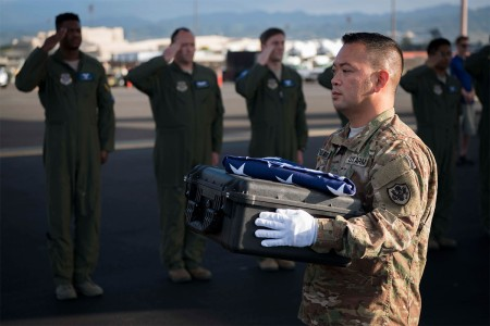 Sgt. 1st Class Roderick Balagtas, assigned to the Defense POW/MIA Accounting Agency (DPAA), carries a case containing possible remains of unidentified service members during a dignified transfer, Joint Base Pearl Harbor-Hickam, Hawaii, Jan. 19, 2017.