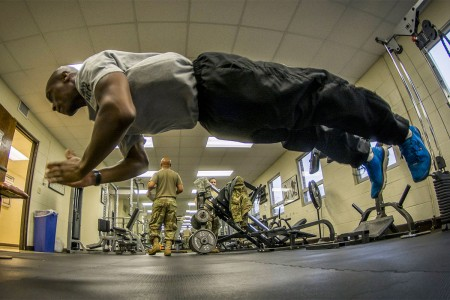 Army Reserve Sgt. Wenceslaus Wallace does pushups in the 335th Signal Command headquarters building in East Point, Ga., Jan. 21, 2017.