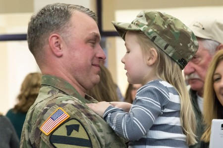 Family members greet their Soldiers after the 204th Engineer Detachment welcome home ceremony, Jan. 28, 2017, in Reynoldsburg, Ohio. Members of the unit returned from their nine month deployment to Afghanistan, where they managed deconstruction and retrograde missions at bases across the country.