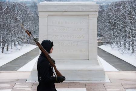 A Tomb Sentinel guards the Tomb of the Unknown Soldier in Arlington National Cemetery, Jan. 30, 2017, in Arlington, Va. The Tomb Sentinels guard the tomb 365 days a year in all weather.