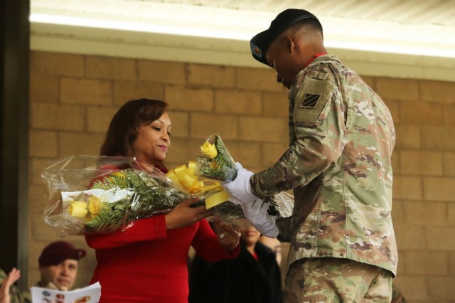 Belle Craven, wife of Command Sgt. Maj. Robert T. Craven, is welcomed to the 3rd Infantry Division Artillery family with a boquet of flowers during an assumption of responsibility ceremony at Marne Garden on Fort Stewart, Ga., Dec. 15, 2017. Craven's husband assumed responsibility as the new DIVARTY command sergeant major. (U.S. Army photo by Pfc. Zoe Garbarino/Released)