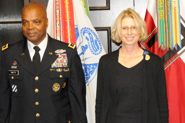 Jimmie Ring (right), First Army Deputy of Operations, Plans and Training, stands beside First Army Commanding General, Lt. Gen. Stephen Twitty, during her retirement ceremony Dec. 14 in First Army headquarters on Rock Island Arsenal, Ill. In her 25-year career, Ring served in a variety of key positions for the Army as a Soldier, civilian and contractor.
