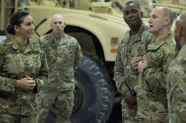 Lt. Gen. Edward Daly, deputy commanding general, U.S. Army Materiel Command speaks with Army Field Support Battalion-Kuwait personnel during a tour of an Army Prepositioned Stocks-5 warehouse at Camp Arifjan, Kuwait, Dec. 9. (U.S. Army Photo by Justin Graff, 401st AFSB Public Affairs)
