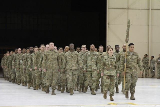 Capt. Amanda Fonk, commander of 227th Composite Supply Company, 129th Combat Sustainment Supply Company, 101st Airborne Division Sustainment Brigade, 101st Abn. Div., marches through the doors at Hanger 3 on Fort Campbell, Kentucky with her Soldiers, Dec. 13, 2017, during the company's welcome home ceremony. Soldiers from 227th CSC, 129th CSSB, returned home after a nine-month deployment in support of Operation Atlantic Resolve in U.S. Army Europe. (U.S. Army photo by Sgt. Caitlyn Byrne/101st SBDE Public Affairs)