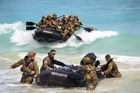 Soldiers assigned to the 25th Infantry Division, make a successful beach landing with their F470 Zodiacs (combat rubber raiding craft) off the coast of Marine Corps Training Area Bellows, Hawaii, Nov. 29, 2017. The Soldiers participated in waterborne training with his unit in the Pacific Ocean.
