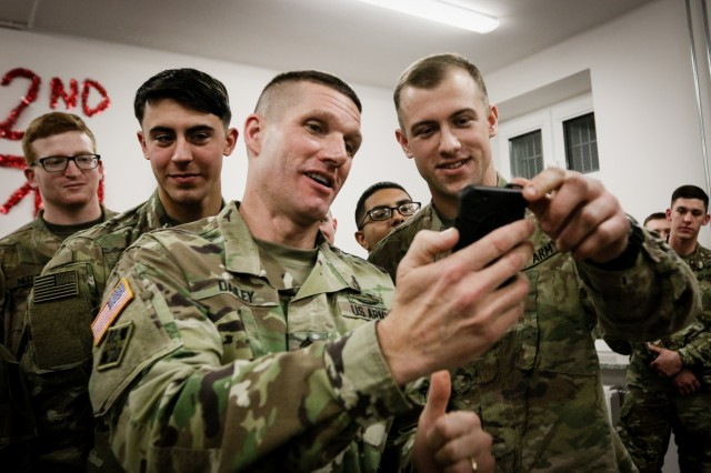Sergeant Major of the Army Daniel A. Dailey (left), calls the mother of Pfc. Brandon Shartzer, a wheeled vehicle mechanic with the 82nd Brigade Engineer Battalion, 2nd Armored Brigade Combat Team, 1st Infantry Division to wish her son a happy birthday in Boleslawiec, Poland, Dec. 16, 2017. The Sergeant Major of the Army serves as the example for enlisted Soldiers from the most junior private to the most senior command sergeant major, and is visiting deployed locations to demonstrate his commitment to the force.