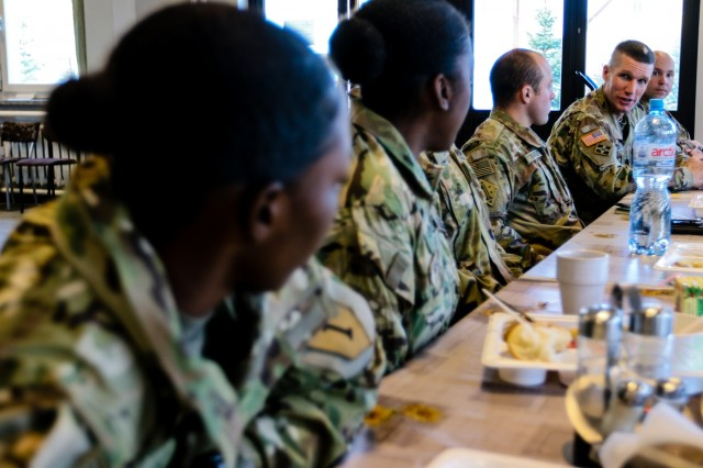 Sergeant Major of the Army Daniel A. Dailey (second from right) gives advice to Soldiers of 5th Squadron, 4th Cavalry Regiment, 2nd Armored Brigade Combat Team, 1st Infantry Division while eating lunch in Swietoszow, Poland, Dec. 16, 2017. The Sergeant Major of the Army serves as the example for enlisted Soldiers from the most junior private to the most senior command sergeant major, and is visiting deployed locations to demonstrate his commitment to the force.