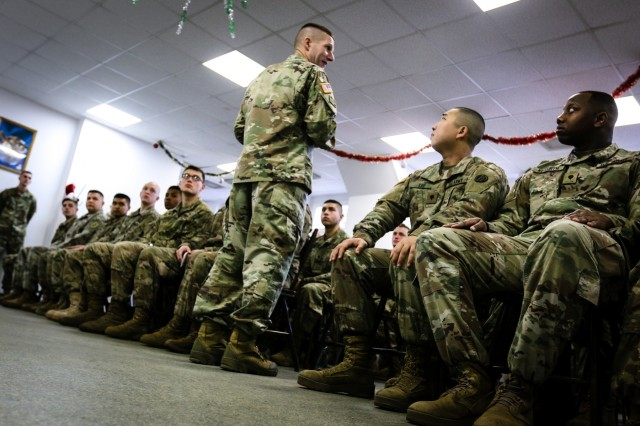Sergeant Major of the Army Daniel A. Dailey (center) gives a speech to the Soldiers of the 2nd Armored Brigade Combat Team, 1st Infantry Division in Zagan, Poland, Dec. 16, 2017. The Sergeant Major of the Army serves as the example for enlisted Soldiers from the most junior private to the most senior command sergeant major and is visiting deployed locations to demonstrate his commitment to the force.