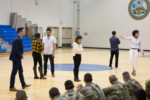 Pure Praxis, a social theater group from Long Beach, Calif., performs during a Sexual Harassment/Assault Response and Prevention (SHARP) training session held at Eifler Gym on Dec. 5.