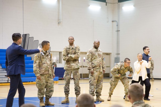 Soldiers and a Department of the Army Civilian from the U.S. Army Intelligence Center of Excellence (USAICoE) participate in Sexual Harassment/Assault Response and Prevention (SHARP) training session held at Eifler Gym on Dec. 5.