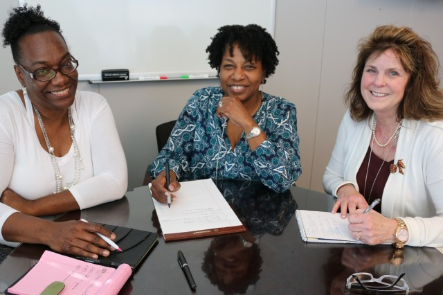 Kim Blanding, a deputy director with the Army Contracting Command-Redstone, center, meets with Aviation and Missile Command Express division chief Felicia Jones, at left, and acting AMCOM Express director Shirley Martin to discuss contracting actions. Blanding will retire from her responsibilities overseeing Aviation and Missile Command contracts at the end of 2017.